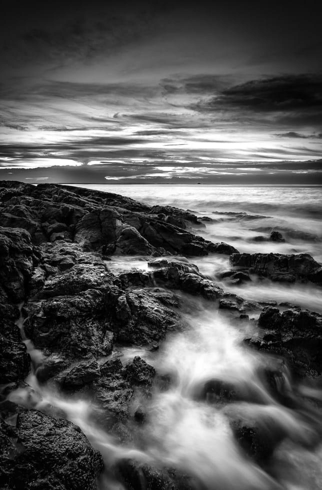 Bamburgh Castle Rocks Black And White Sunset